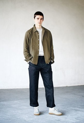 Olive Long Sleeve Shirt Outfits For Men: Want to infuse your menswear collection with some relaxed casual cool? Marry an olive long sleeve shirt with navy chinos. Send this outfit down a more laid-back path by wearing a pair of white canvas low top sneakers.