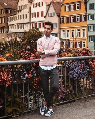 Light Blue Vertical Striped Long Sleeve Shirt Outfits For Men: If you gravitate towards relaxed casual style, why not try this combination of a light blue vertical striped long sleeve shirt and charcoal chinos? Navy and white canvas low top sneakers look perfect complementing your getup.