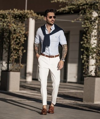Brown Leather Tassel Loafers Outfits: If you're a fan of casual combinations, why not take this pairing of a light blue vertical striped long sleeve shirt and white chinos for a walk? Puzzled as to how to finish off this outfit? Wear a pair of brown leather tassel loafers to elevate it.