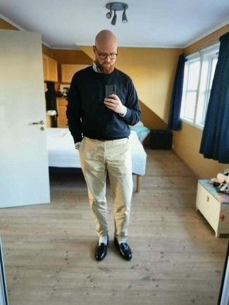 1200+ Outfits For Men After 40: A light blue vertical striped long sleeve shirt and beige chinos? It's easily a wearable look that you can wear a variation of on a day-to-day basis. Tap into some David Beckham stylishness and smarten up your ensemble with black leather loafers. A wonderful example for any gent who wonders how to dress age-appropriately while still looking stylish.