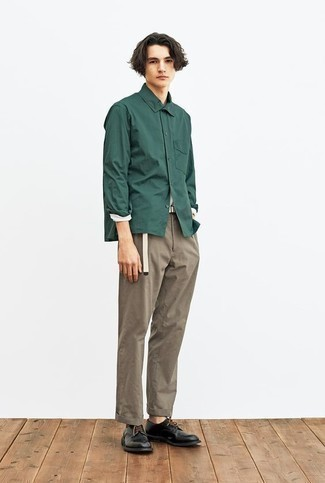 Dark Green Long Sleeve Shirt Outfits For Men: A dark green long sleeve shirt and brown chinos are essential in any guy's functional off-duty closet. A pair of black leather derby shoes effortlessly steps up the wow factor of any outfit.