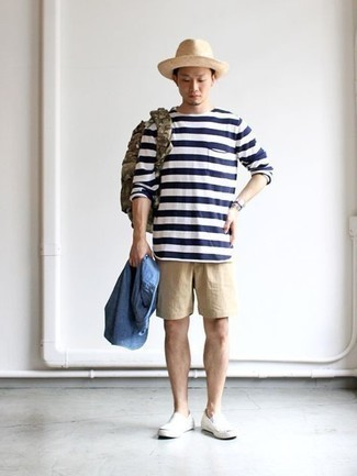 Hat Outfits For Men: Such must-haves as a blue chambray long sleeve shirt and a hat are the ideal way to introduce effortless cool into your daily fashion mix. Feeling inventive today? Class up your outfit by slipping into white canvas slip-on sneakers.
