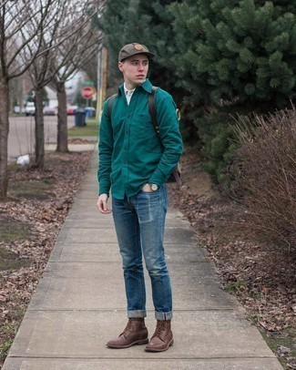 Tan Canvas Backpack Outfits For Men: This modern casual pairing of a dark green long sleeve shirt and a tan canvas backpack can only be described as seriously dapper. Why not take a classic approach with shoes and complement this ensemble with a pair of dark brown leather casual boots?