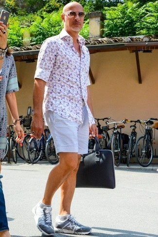 How to Wear a Navy Canvas Briefcase: Reach for a white print long sleeve shirt and a navy canvas briefcase to put together an interesting and current bold casual ensemble. To bring a bit of flair to this ensemble, complement your ensemble with a pair of light blue athletic shoes.