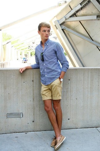 How to wear: blue gingham long sleeve shirt, tan shorts, tan leather boat shoes, black sunglasses