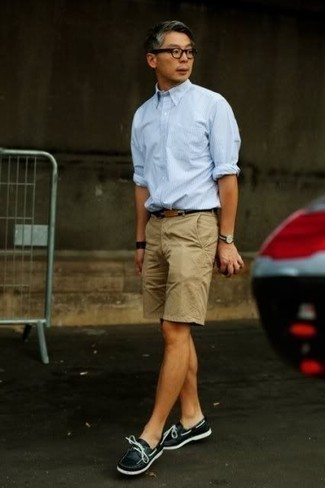 How to Wear Black Boat Shoes: Teaming a light blue vertical striped long sleeve shirt with tan shorts is an on-point idea for a laid-back yet seriously stylish look. Complement this look with a pair of black boat shoes and the whole getup will come together brilliantly.
