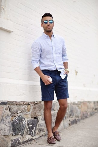How to Wear Boat Shoes: Go for casually cool style in a light blue long sleeve shirt and navy shorts. A pair of boat shoes serves as the glue that pulls your ensemble together.