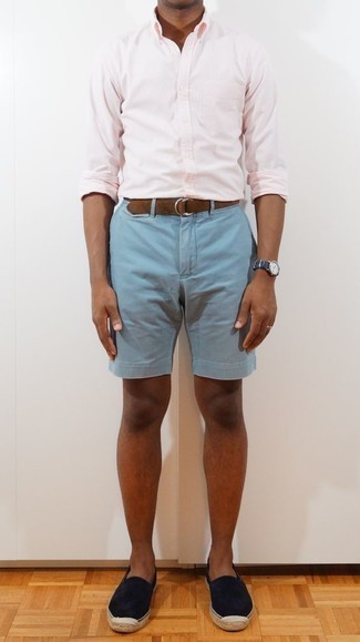 How to Wear Light Blue Shorts For Men: A pink vertical striped long sleeve shirt and light blue shorts combined together are a nice match. If in doubt about the footwear, go with navy suede espadrilles.