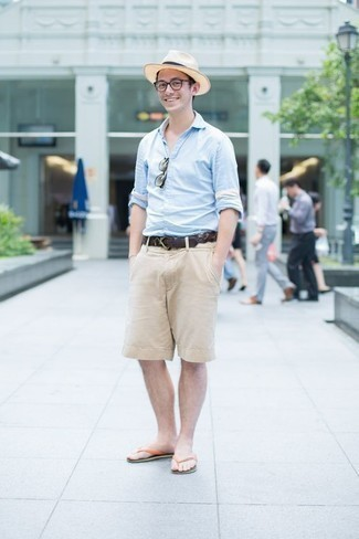 How to Wear Flip Flops For Men: Make a light blue long sleeve shirt and beige shorts your outfit choice for a casual look with a contemporary spin. If you wish to effortlessly tone down this outfit with one item, complement your look with a pair of flip flops.