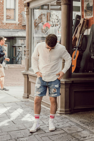 White Canvas High Top Sneakers Outfits For Men: Go for a white linen long sleeve shirt and blue ripped denim shorts for relaxed dressing with a twist. For maximum impact, complete this look with white canvas high top sneakers.