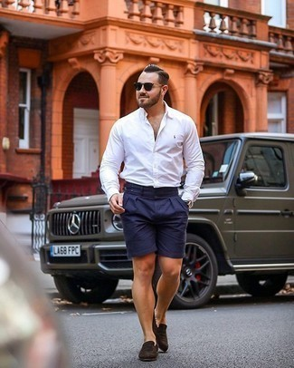 Navy Shorts with Suede Dress Shoes Smart Casual Summer Outfits For Men: If you need to feel confident in your outfit, go for a white long sleeve shirt and navy shorts. For something more on the sophisticated side to finish off this ensemble, complete your getup with a pair of suede dress shoes. So if it's a baking hot hot weather afternoon and you want to look on-trend without exerting much effort, this outfit will do the job in no time flat.