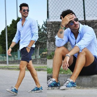How to wear: light blue long sleeve shirt, navy shorts, blue floral low top sneakers, navy sunglasses
