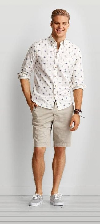 How to wear: white print long sleeve shirt, beige shorts, grey canvas low top sneakers, dark brown leather watch