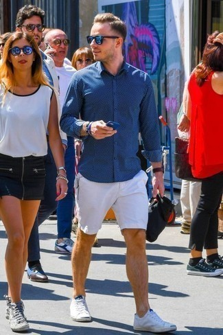 Men's Looks & Outfits: What To Wear In 2020: A navy print long sleeve shirt and white shorts have cemented themselves as absolute menswear must-haves. Complement this outfit with white canvas low top sneakers and the whole look will come together perfectly.