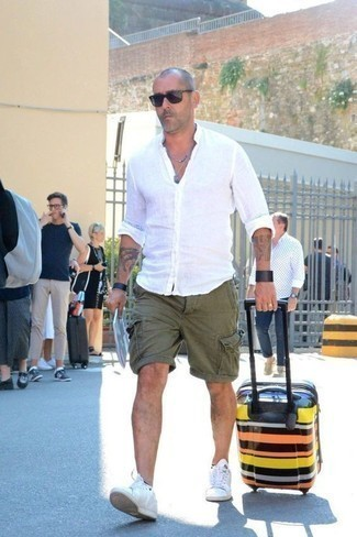 Black Leather Bracelet Outfits For Men After 40: This combo of a white linen long sleeve shirt and a black leather bracelet is indisputable proof that a simple casual ensemble doesn't have to be boring. Channel your inner Idris Elba and dress up your look with a pair of white leather low top sneakers. Like this idea for your styling collection as a mature gentleman?