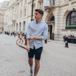 Light Blue Long Sleeve Shirt Outfits For Men: Rock a light blue long sleeve shirt with navy shorts if you want to look casually dapper without trying too hard. Complement this look with a pair of light blue canvas low top sneakers and the whole getup will come together really well.