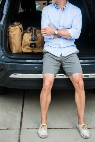 A baby blue button-down shirt and shorts is a smart combo to add to your casual lineup. White sneakers are a wonderful choice to complete the look.