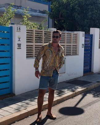 Sandals Outfits For Men: This combo of a mustard paisley long sleeve shirt and blue denim shorts is uber versatile and provides a laid-back and cool look. And if you need to immediately dial down this outfit with footwear, why not introduce sandals to the mix?