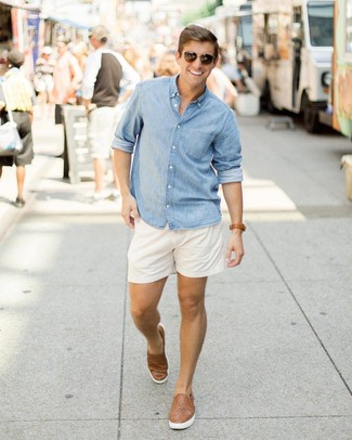 How to wear: light blue chambray long sleeve shirt, white shorts, brown woven leather slip-on sneakers, dark brown sunglasses