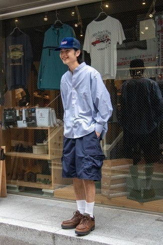 Light Blue Long Sleeve Shirt Outfits For Men: Exhibit your chops in menswear styling by wearing this laid-back pairing of a light blue long sleeve shirt and navy shorts. Rounding off with brown leather work boots is an easy way to introduce a more laid-back feel to your ensemble.