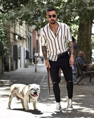 Black Ripped Skinny Jeans Outfits For Men: This relaxed casual pairing of a white vertical striped long sleeve shirt and black ripped skinny jeans is capable of taking on different nuances depending on the way you style it. Complete this outfit with a pair of brown canvas high top sneakers and you're all done and looking smashing.