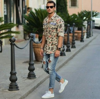 How to Wear White Leather Low Top Sneakers In a Relaxed Way For Men: Reach for an olive camouflage long sleeve shirt and blue ripped skinny jeans if you're on a mission for a look idea for when you want to look laid-back and cool. If you want to immediately up your ensemble with shoes, why not add a pair of white leather low top sneakers to the equation?