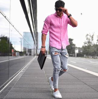 How to wear: hot pink linen long sleeve shirt, light blue ripped skinny jeans, white low top sneakers, black leather zip pouch