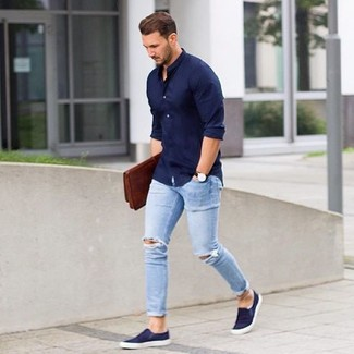 Pair a deep blue long sleeve shirt with baby blue destroyed slim jeans for a casual level of dress. Finish off this look with slip-on sneakers.