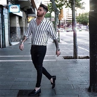 How to Wear Black Leather Tassel Loafers: A white and black vertical striped long sleeve shirt and black ripped skinny jeans will add serious style to your off-duty rotation. Feeling bold? Shake things up by rounding off with a pair of black leather tassel loafers.