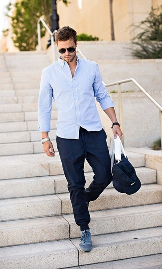 How to wear: light blue long sleeve shirt, navy sweatpants, navy athletic shoes, navy canvas duffle bag