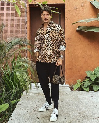 Sweatpants Outfits For Men: This pairing of a tan leopard long sleeve shirt and sweatpants is undeniable proof that a pared down casual outfit doesn't have to be boring. Change up this look with a sleeker kind of shoes, such as this pair of white and black print leather low top sneakers.
