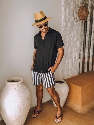 Flip Flops Outfits For Men: If you gravitate towards relaxed style, why not try this pairing of a black long sleeve shirt and black and white swim shorts? For something more on the daring side to finish off your outfit, add a pair of flip flops to the mix.