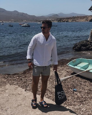Sandals Outfits For Men: A white long sleeve shirt and black and white print swim shorts will add serious dapperness to your casual routine. Sandals are a simple way to add a little kick to the outfit.