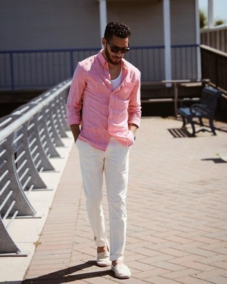 Men's Outfits 2021: On days when comfort is the priority, wear a pink long sleeve shirt with white chinos. If you're hesitant about how to finish off, add grey horizontal striped canvas espadrilles to this outfit.