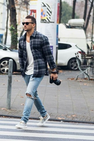 How to wear: charcoal plaid flannel long sleeve shirt, white tank, light blue ripped jeans, white and black print canvas low top sneakers