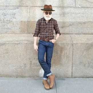 How to Wear Beige Leather Casual Boots For Men: For comfort dressing with a clear fashion twist, pair a brown plaid long sleeve shirt with navy jeans. Complete this outfit with beige leather casual boots to switch things up.