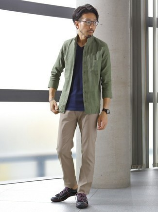 Olive Long Sleeve Shirt Outfits For Men: For an ensemble that's super straightforward but can be manipulated in a variety of different ways, make an olive long sleeve shirt and beige chinos your outfit choice. Have some fun with things and add a pair of black canvas low top sneakers to the mix.