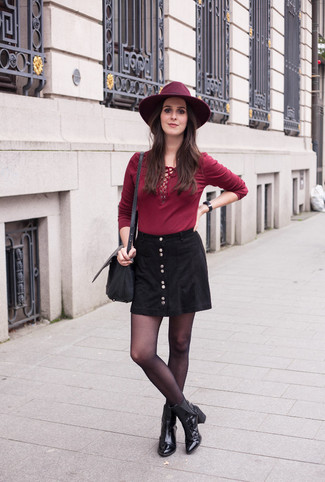 An oxblood long sleeve t-shirt and a button skirt is a great combination to carry you throughout the day. A pair of black leather ankle boots will add some real flair to this outfit. A look like this makes it easy to embrace weird transeasonal weather.