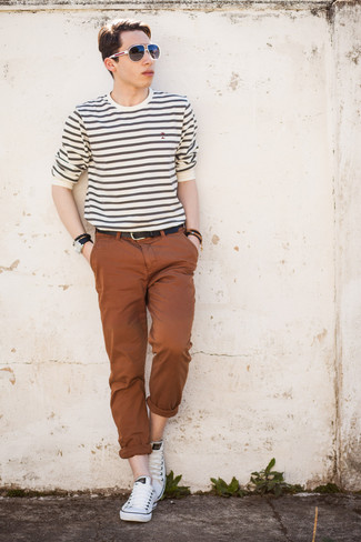 How to Wear Black and White Sunglasses For Men: If you gravitate towards comfort dressing, why not rock a white horizontal striped long sleeve t-shirt with black and white sunglasses? For a classier touch, introduce white low top sneakers to your outfit.