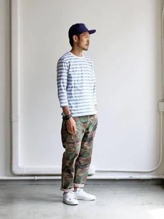 How to Wear Camouflage Pants In Summer For Men: A white and blue horizontal striped long sleeve t-shirt looks especially cool when worn with camouflage pants in a relaxed getup. A pair of white low top sneakers easily boosts the wow factor of your outfit. Needless to say, you're looking at a nice idea for an extremely hot warm weather afternoon.