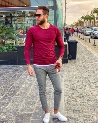 White Canvas Low Top Sneakers Outfits For Men: A burgundy long sleeve t-shirt and grey chinos are essential in any gent's great off-duty collection. If in doubt about what to wear in the footwear department, grab a pair of white canvas low top sneakers.