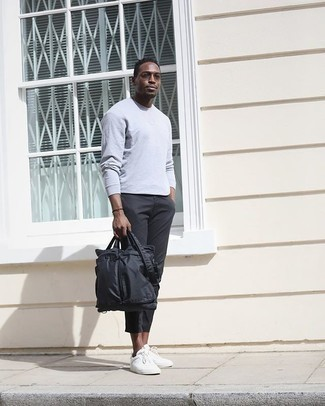 Black Nylon Briefcase Casual Outfits: This combo of a grey long sleeve t-shirt and a black nylon briefcase will allow you to display your expertise in menswear styling even on dress-down days. A pair of white canvas low top sneakers immediately spruces up any look.