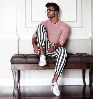 Men's Outfits 2021: Sharp yet practical, this getup combines a pink long sleeve t-shirt and white and navy vertical striped chinos. Complement this outfit with white and red canvas low top sneakers and off you go looking smashing.