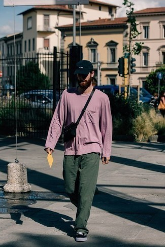 Chinos Outfits: To create an off-duty ensemble with a modernized spin, try teaming a purple long sleeve t-shirt with chinos. Black and white canvas low top sneakers pull the outfit together.