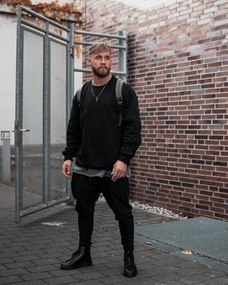 Grey Crew-neck T-shirt Outfits For Men: For comfort dressing with a modern spin, team a grey crew-neck t-shirt with black chinos. Black leather casual boots are an effective way to infuse an extra dose of style into your ensemble.