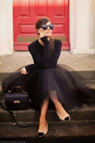 A black long sleeve t-shirt and a black full skirt feel perfectly suited for weekend activities of all kinds. Black and tan leather ballerina flats will give your look an on-trend feel.