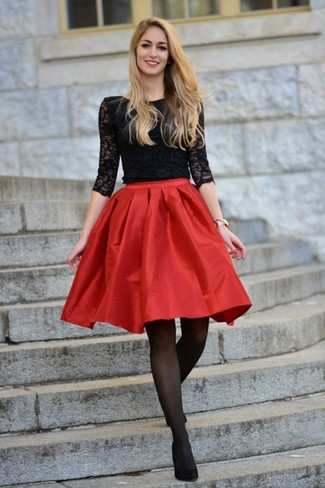 How to Wear Black Suede Pumps: This combo of a black lace long sleeve t-shirt and a red satin full skirt makes for the perfect foundation for a great number of stylish combos. Get a bit experimental when it comes to shoes and spruce up your look by slipping into a pair of black suede pumps.