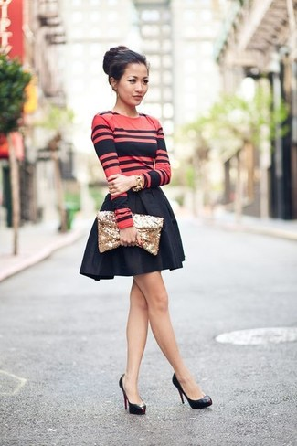 Consider teaming a red and black horizontal striped long sleeve t-shirt with a black full skirt for a casual level of dress. Black leather pumps will bring a classic aesthetic to the ensemble.