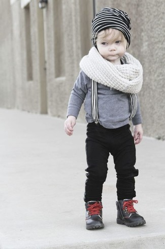 How to Wear a White and Black Horizontal Striped Beanie For Boys: Consider dressing your son in a grey long sleeve t-shirt with a white and black horizontal striped beanie for a laid-back yet fashion-forward outfit. This outfit is complemented brilliantly with black leather boots.