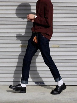 How to Wear Navy Jeans For Men: Why not marry a burgundy long sleeve t-shirt with navy jeans? Both of these pieces are very comfortable and will look nice when combined together. Our favorite of a myriad of ways to complement this look is with a pair of black leather derby shoes.